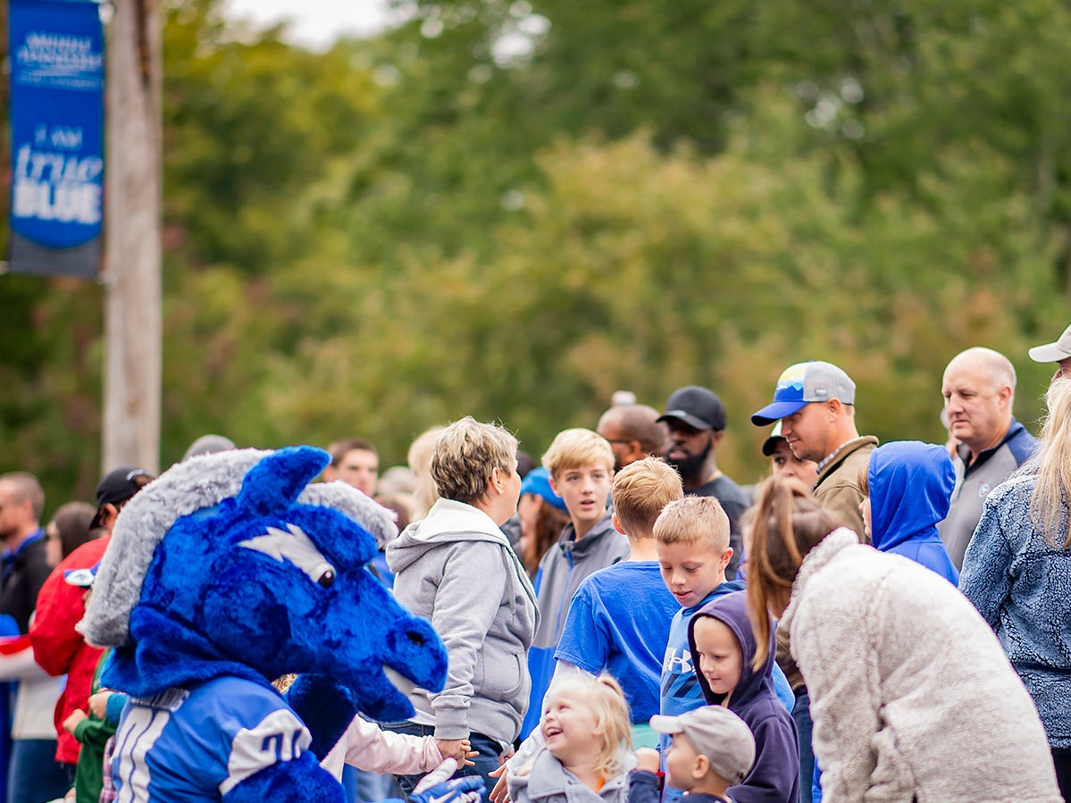 MTSU mascot Lightning plays with kids during the homecoming parade.