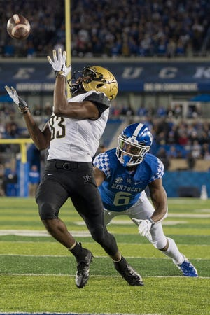 Vanderbilt wide receiver C.J. Bolar (83) catches a touchdown pass during the first half of an NCAA college football game against Kentucky in Lexington, Ky., Saturday, Oct. 20, 2018.