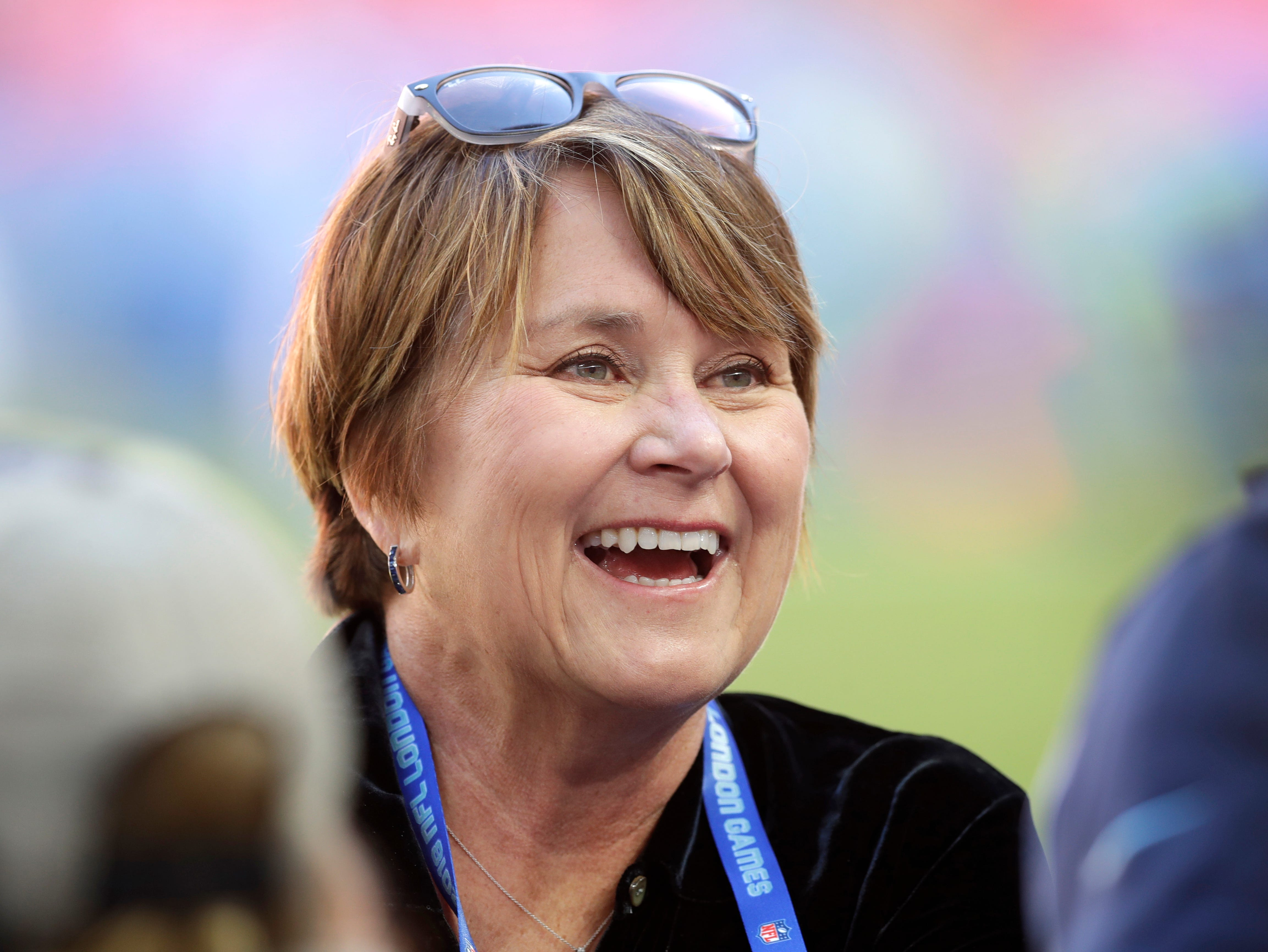 Amy Adams Strunk, the controlling owner of the Tennessee Titans smiles before an NFL football game against Los Angeles Chargers at Wembley stadium in London, Sunday, Oct. 21, 2018.