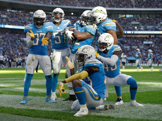Chargers players celebrate after making a turnover during the first half Sunday.