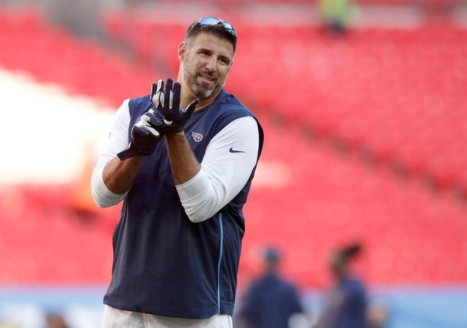Tennessee Titans head coach Mike Vrabel stands on the pitch before an NFL football game against Los Angeles Chargers at Wembley stadium in London, Sunday, Oct. 21, 2018.