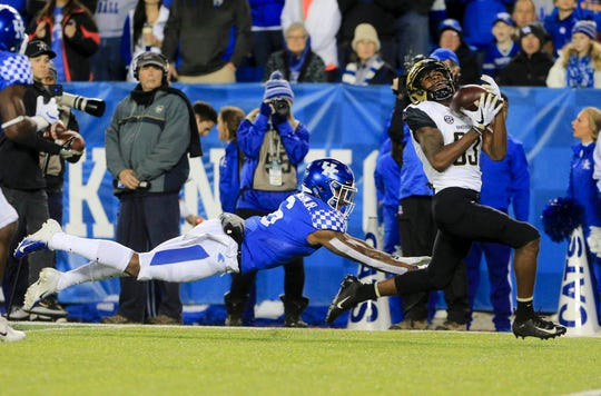 Oct 20, 2018; Lexington, KY, USA; Vanderbilt Commodores wide receiver C.J. Bolar (83) catches the ball against Kentucky Wildcats cornerback Lonnie Johnson Jr.(6) in the first half at Kroger Field.