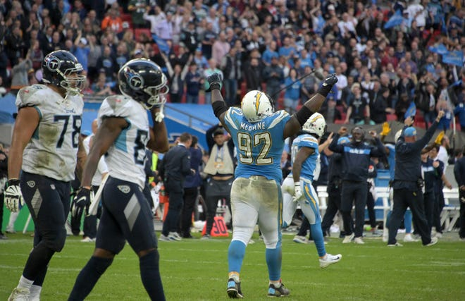 Chargers defensive tackle Brandon Mebane (92) celebrates after a failed two-point conversion by the Titans on Sunday.