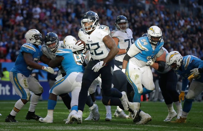 Tennessee Titans running back Derrick Henry (22) runs through to score a touchdown during the first half of an NFL football game against Los Angeles Chargers at Wembley stadium in London, Sunday, Oct. 21, 2018.