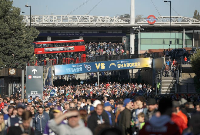Fans pack Wembley Way as they arrive for the game between the Titans and Los Angeles Chargers on Sunday at Wembley Stadium in London.