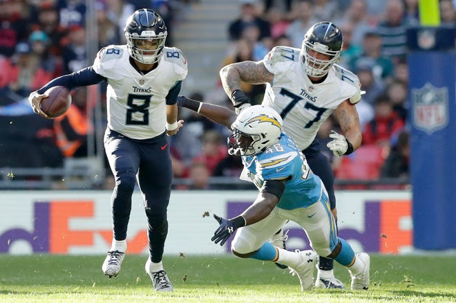 Oct. 21: Chargers 20, Titans 19 --  Tennessee Titans quarterback Marcus Mariota (8) escapes the challenge of Los Angeles Chargers defensive end Chris Landrum (46) during the first half of an NFL football game at Wembley stadium in London, Sunday, Oct. 21, 2018.