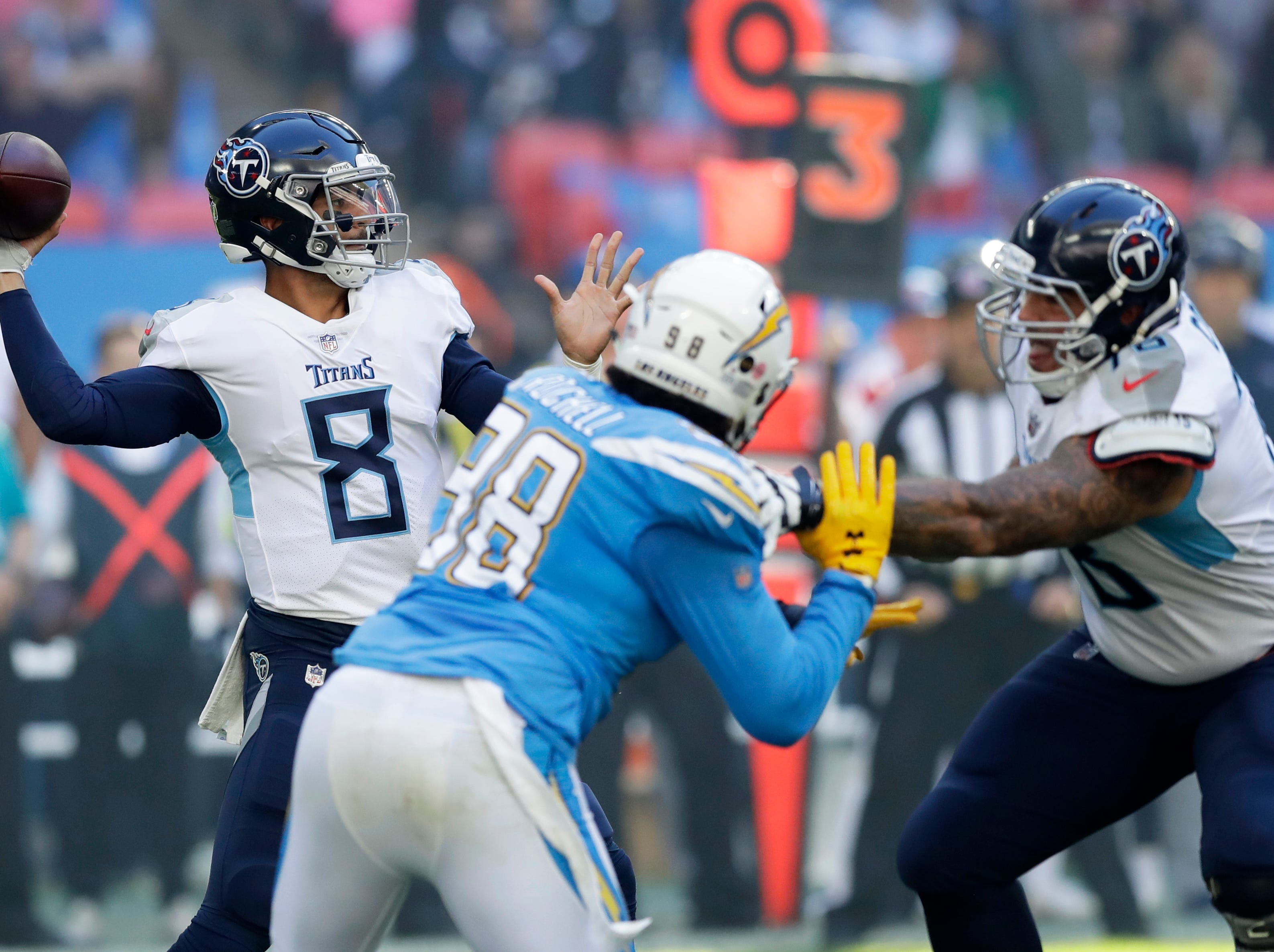 Tennessee Titans quarterback Marcus Mariota (8) passes the ball during the first half of an NFL football game against Los Angeles Chargers at Wembley stadium in London, Sunday, Oct. 21, 2018.
