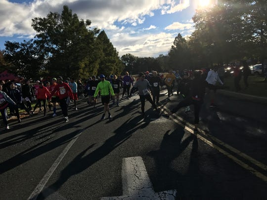 Racers stretch before the Marty Roemer 10K in Paramus on Oct. 20, 2018.