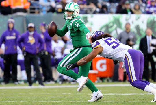 Sam Darnold fights off a tackle as he runs for a first down against the Vikings.  Sunday, October 21, 2018