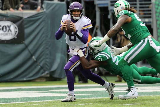 Kirk Cousins, of the Vikings, is tackled by Brandon Copeland, of the Jets, within one yard of a safety. Sunday, October 21, 2018