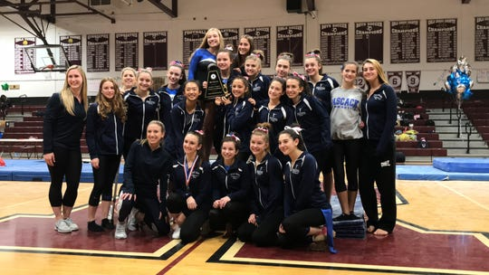 The Pascack Regional gymnastics team with the championship trophy from the Bergen County gymnastics meet on Friday, Oct. 19, 2018. Pascack outscored Holy Angels, 106.025-105.375, for its first Bergen title since 2010.