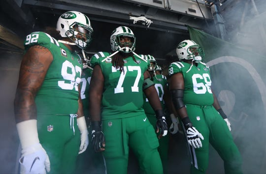 Leonard Williams, James Carpenter and Kelvin Beachum get ready to lead the Jets onto the field. Sunday, October 21, 2018