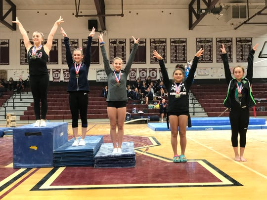 Holy Angels' Faith Furletti (far left) repeated as all-around champion at the Bergen County gymnastics meet on Friday, Oct. 19, 2018. She was joined on the podium by Pascack Regional's Maya Horowitz (2nd), Ridgewood's Luz van Schijndel (3rd) and Penelope Caswell (4th) and Ramapo's Sidney Schreiber (5th).