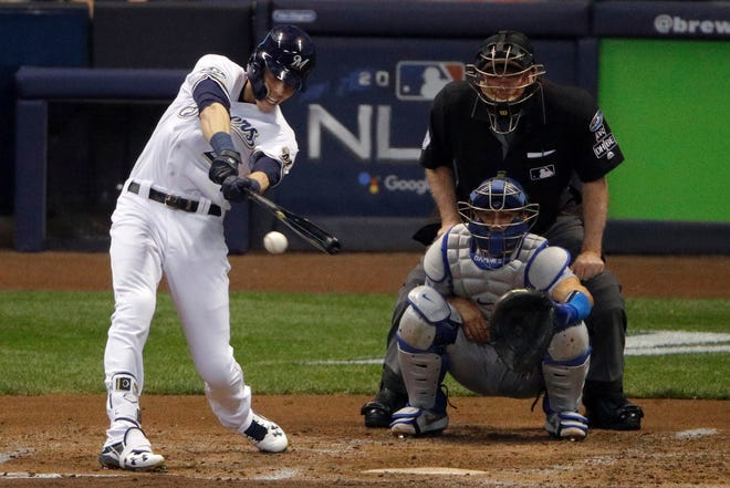 Milwaukee Brewers' Christian Yelich (22) hits a double during the second inning of Game 6 of the National League Championship Series baseball game against the Los Angeles Dodgers Friday, Oct. 19, 2018, in Milwaukee.