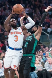 New York Knicks guard Tim Hardaway Jr. (3) goes to the basket against Boston Celtics guard Kyrie Irving (11) during the first half of an NBA basketball game, Saturday, Oct. 20, 2018, at Madison Square Garden in New York.