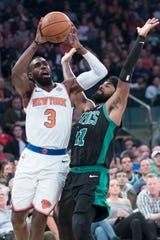 New York Knicks Guard Tim Hardaway Jr. (3) goes to the basket against Boston Celtics guard Kyrie Irving (11) during the first half of an NBA basketball game, Saturday, Oct. 20, 2018 at Madison Square Garden in New York.