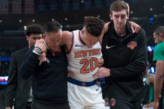 New York Knicks forward Kevin Knox (20) is helped off the court after injuring himself during the first half of an NBA basketball game against the Boston Celtics, Saturday, Oct. 20, 2018, at Madison Square Garden in New York.