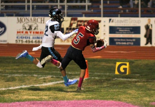 Senior Ozzy Lopez (5) pulled in this Daniel Garcia pass for a 23-yard touchdown.
