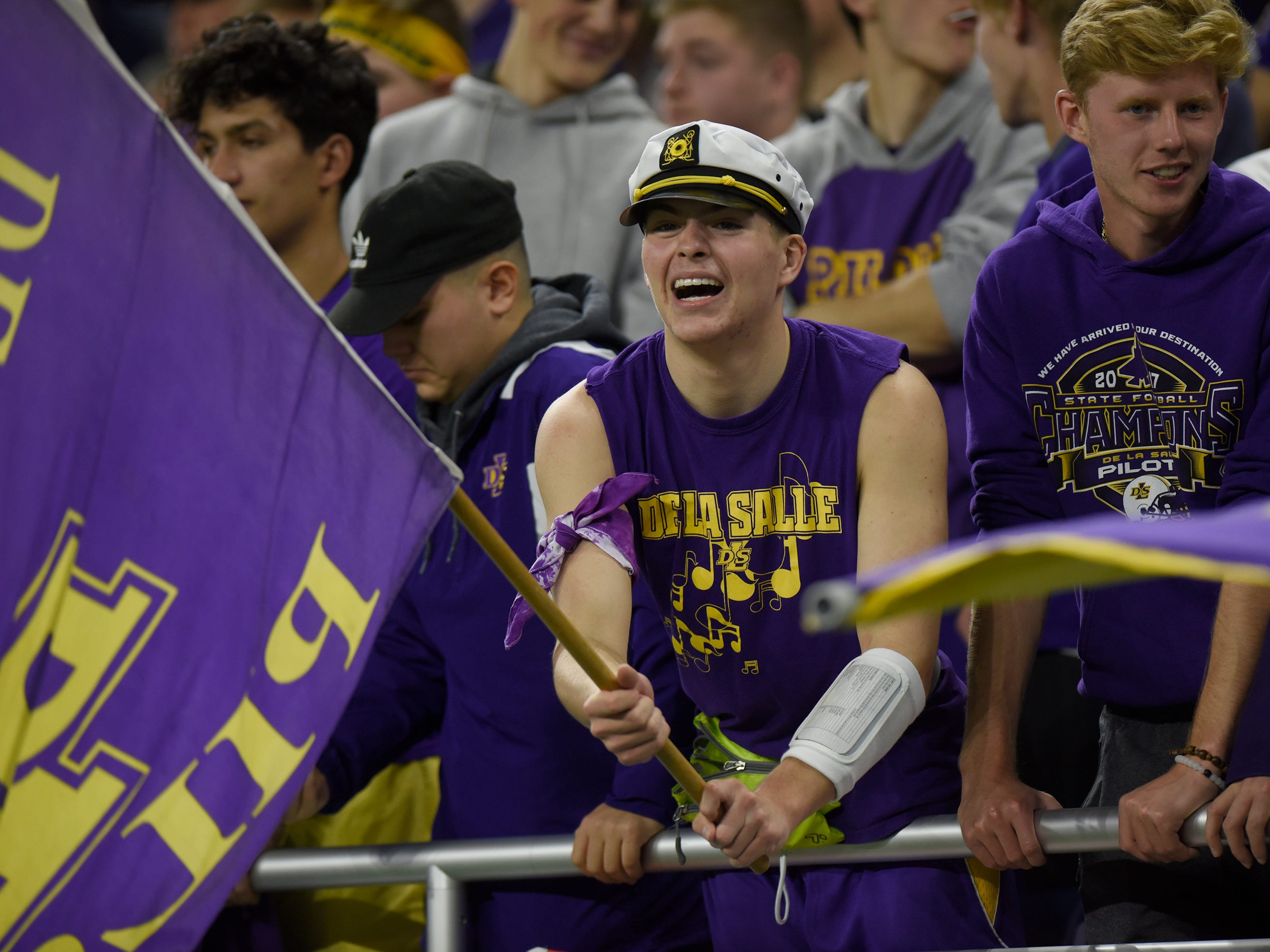 Warren De La Salle students cheer on the Piolts during Catholic League Prep Bowl AB Division championship game at Ford Field Oct. 20, 2018.