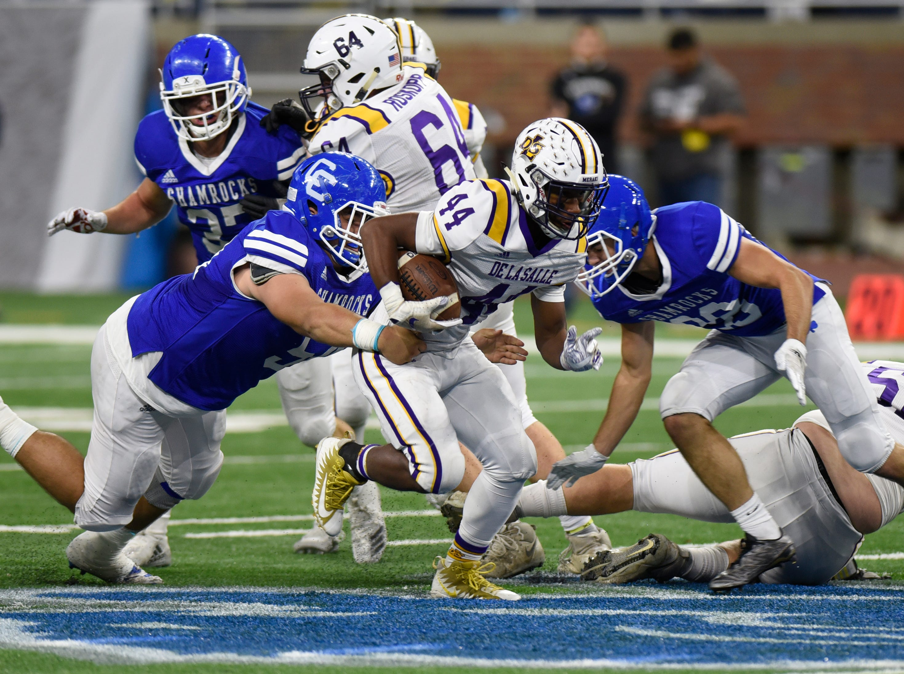 Warren De La Salle running back Jordan Rogers (44) runs the ball during Catholic League Prep Bowl AB Division championship game at Ford Field Oct. 20, 2018.