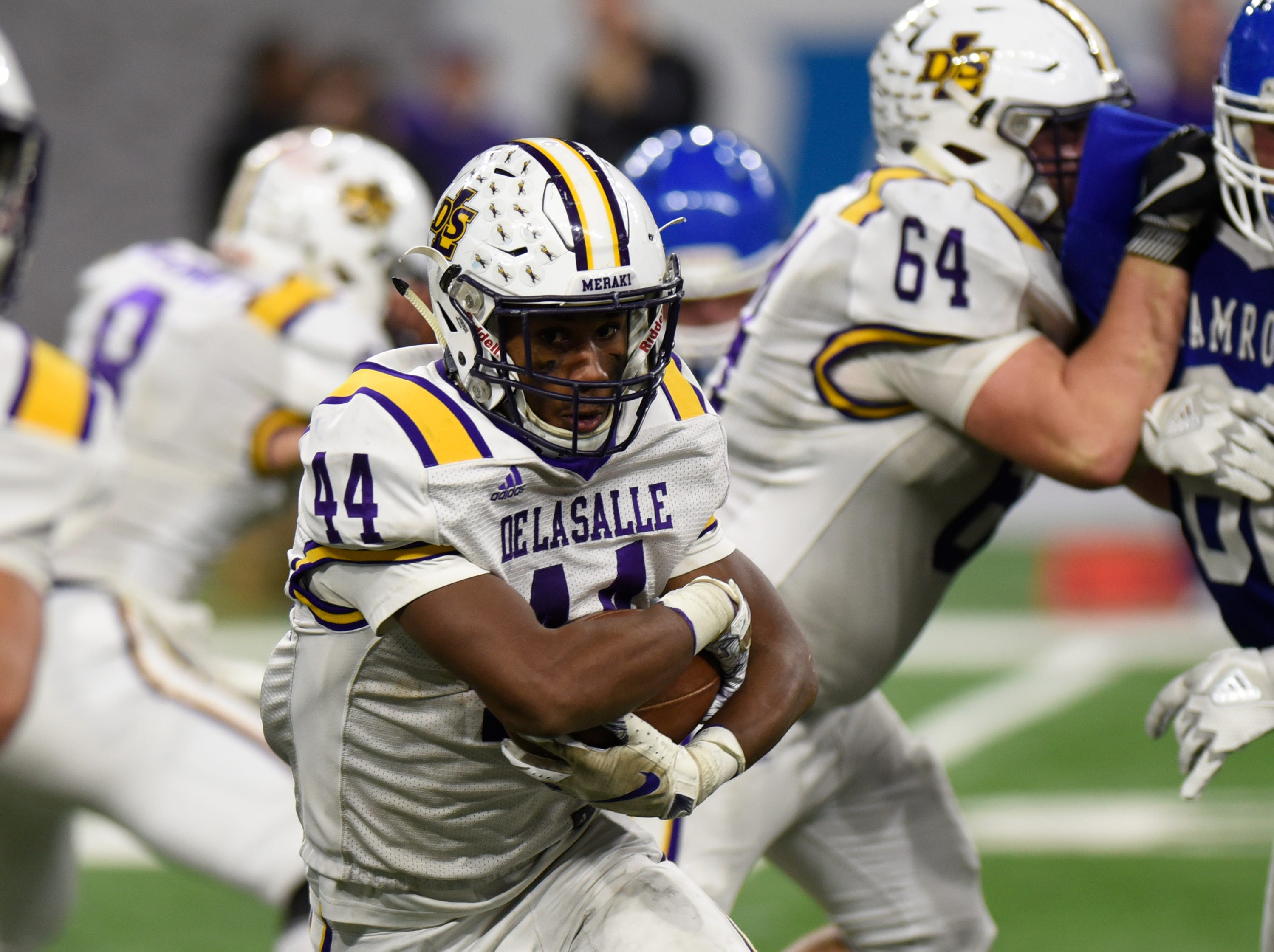 Warren De La Salle running back Jordan Rogers (44) carries the ball during Catholic League Prep Bowl AB Division championship game at Ford Field Oct. 20, 2018.