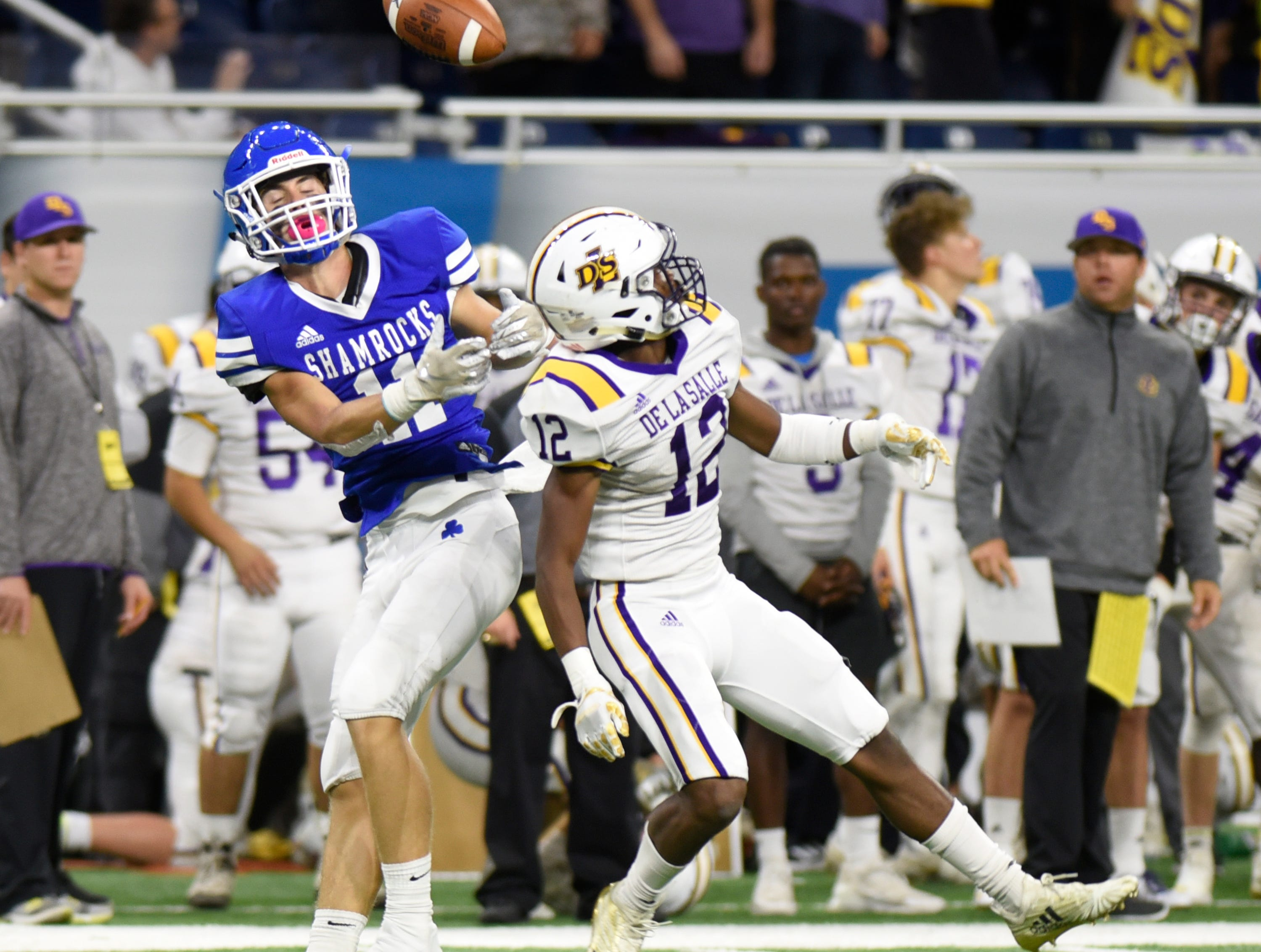Detroit Catholic Central's Nate Anderson (11) can't bring in this pass while being defended by Warren De La Salle defensive back Rickey Pearson II (12) during the Catholic League Prep Bowl AB Division championship game at Ford Field Oct. 20, 2018.