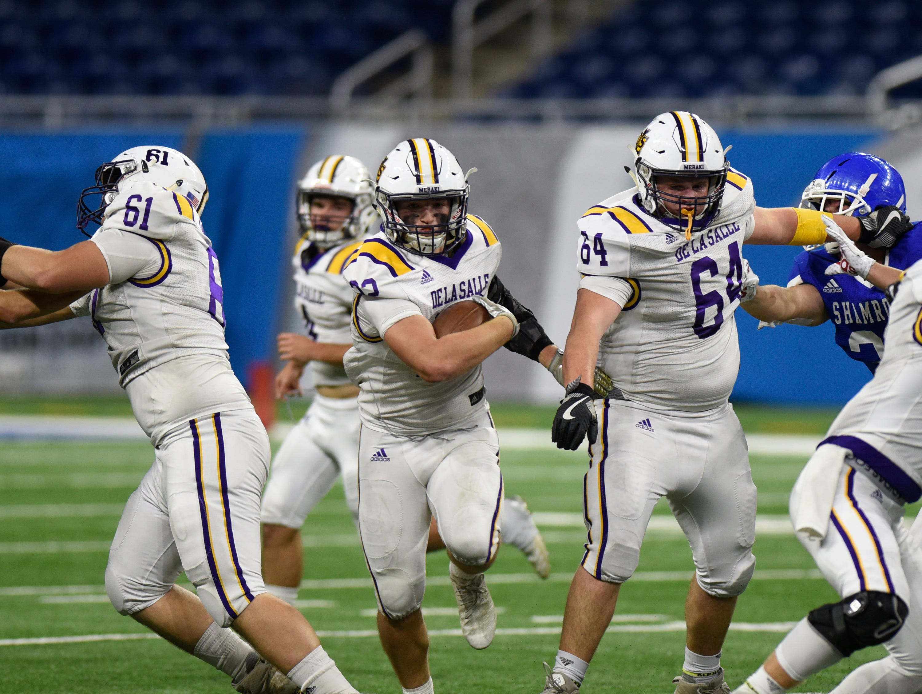 Warren De La Salle running back/DB Evan Vaillancourt (22) runs the ball during Catholic League Prep Bowl AB Division championship game at Ford Field Oct. 20, 2018.