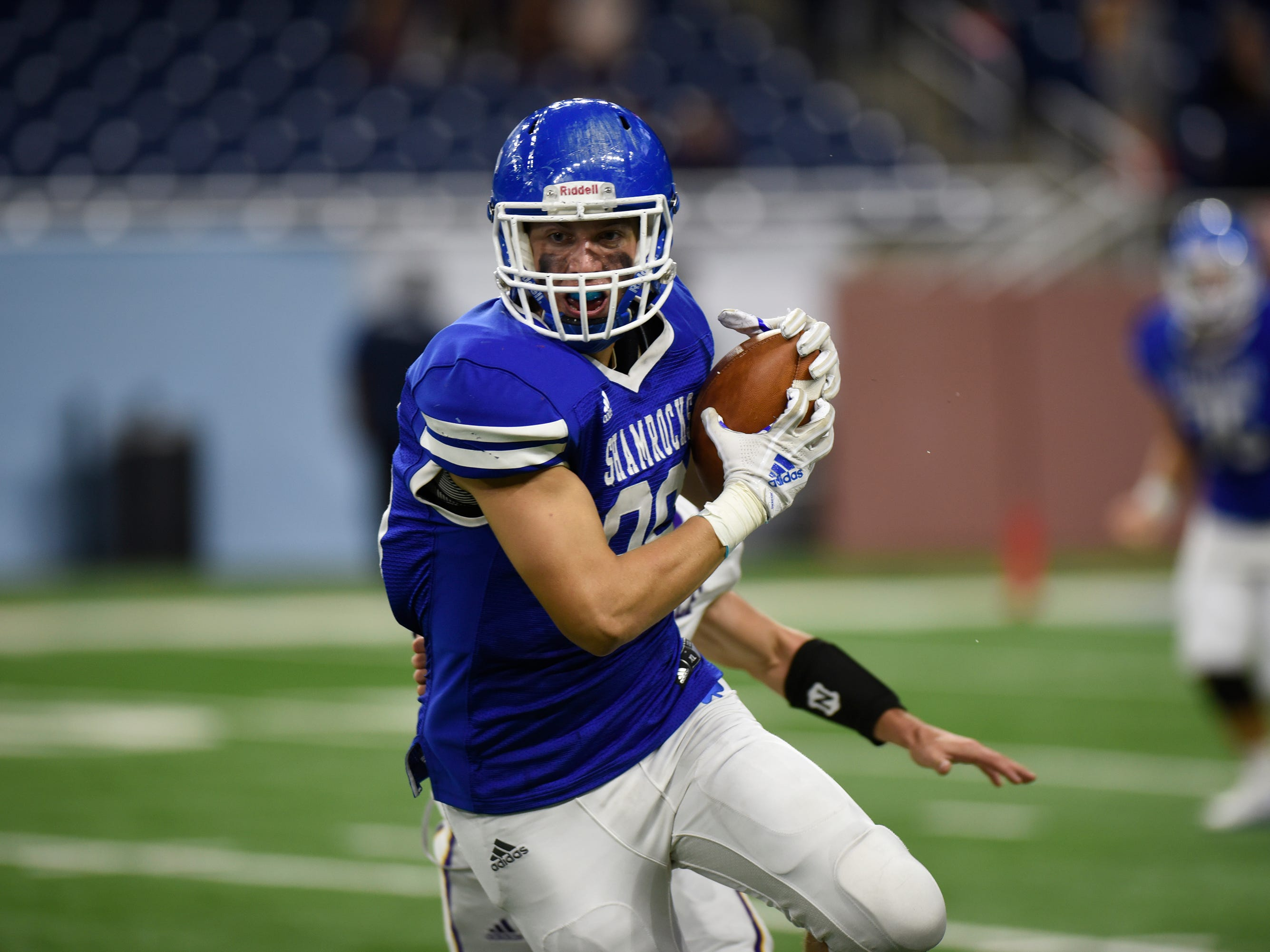 Detroit Catholic Central TE/DE Mike Harding (86) runs after catching a pass during Catholic League Prep Bowl AB Division championship game at Ford Field Oct. 20, 2018.