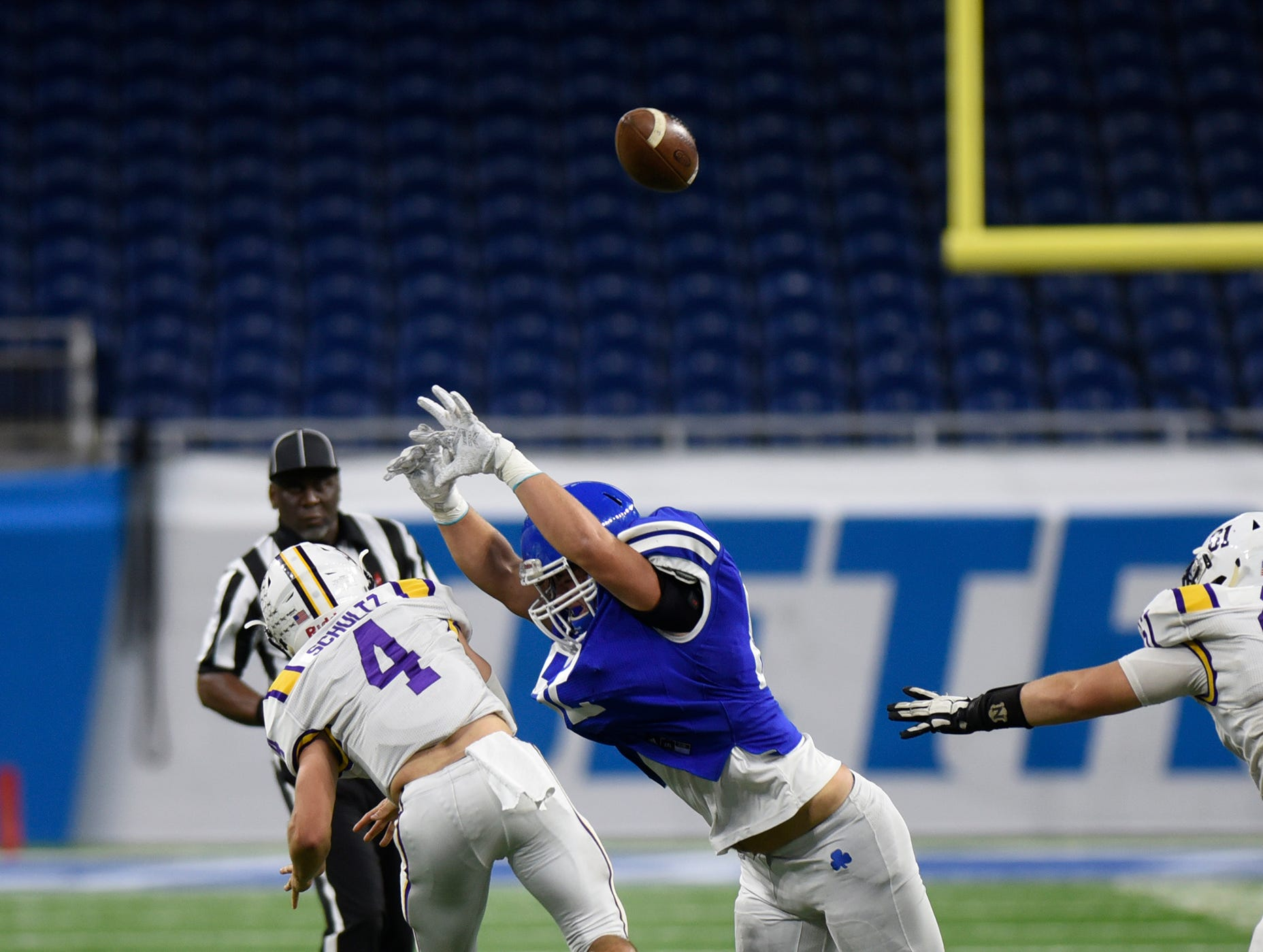 Warren De La Salle quarterback Nolan Schultz (4) gets a pass away just before DCC defenders move in during the Catholic League Prep Bowl AB Division championship game at Ford Field Oct. 20, 2018.