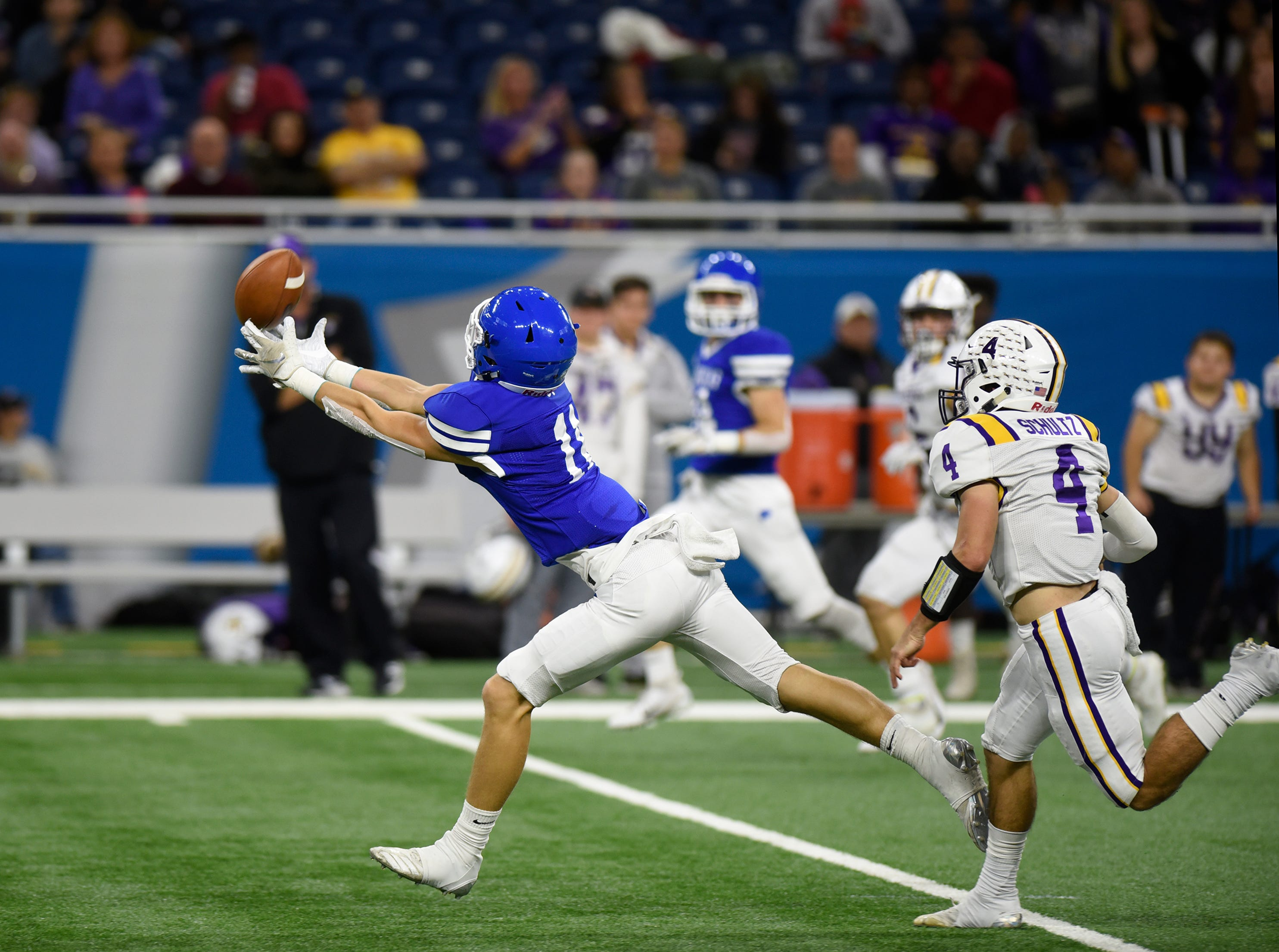 Detroit Catholic Central WR/DB Nate Anderson (11) gets his fingertips on this first quarter pass but cannot bring it in as Warren De La Salle's Nolan Schultz (4) covers during Catholic League Prep Bowl AB Division championship game at Ford Field Oct. 20, 2018.