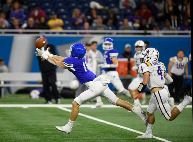 Catholic Central's Nate Anderson (11) gets his fingertips on this first quarter pass, but cannot bring it in asDe La Salle's Nolan Schultz (4) covers during Catholic League Prep Bowl A-B Division final on Oct. 20 at Ford Field.