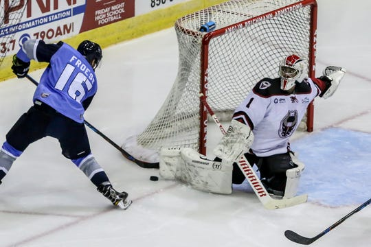 Pensacola's Tanner Froese (16) moves in close to the net to try and get an angle on Birmingham goalie Charlie Millen (1) in the Ice Flyers' season home opener on Saturday, October 20, 2018, at the Pensacola Bay Center. The Ice Flyers led 2-0 in the second period, but the Bulls scored three unanswered goals to win the game in front of over 7,200 fans, the largest home opener in the team's history.