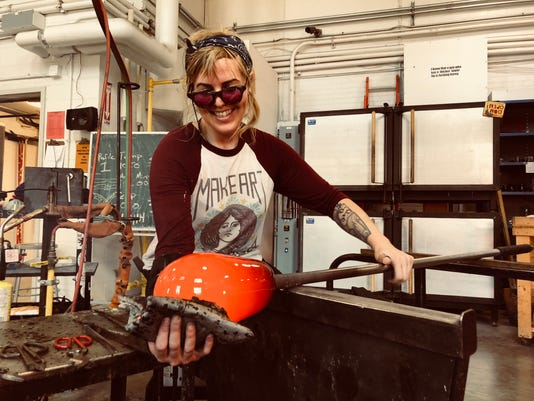Hillary Heckard works with glass