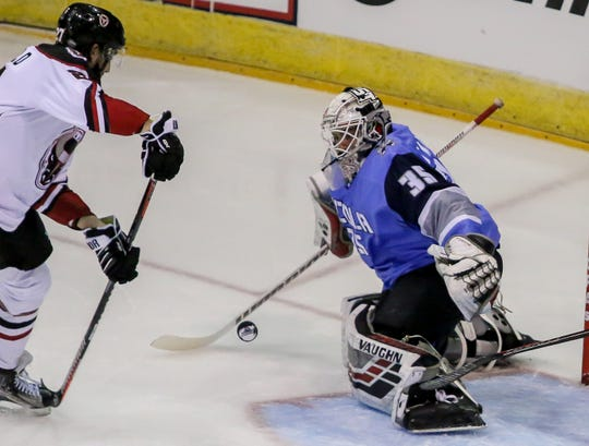 Pensacola goalie Andrew D'Agostini (35) works to keep Birmingham's Geoff Crisfield (27) from getting a rebound shot in the Ice Flyers' season home opener on Saturday, October 20, 2018, at the Pensacola Bay Center. The Ice Flyers led 2-0 in the second period, but the Bulls scored three unanswered goals to win the game in front of over 7,200 fans, the largest home opener in the team's history.