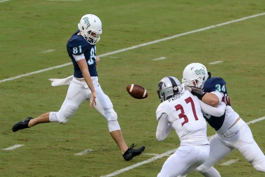 UWF's Dawson Hamlin (81) punts the ball against Florida Tech in the Coastal Classic rivalry game at Blue Wahoos Stadium on Saturday, October 20, 2018. Due numerous weather delays, the game started an hour and forty minutes after the originally scheduled time.