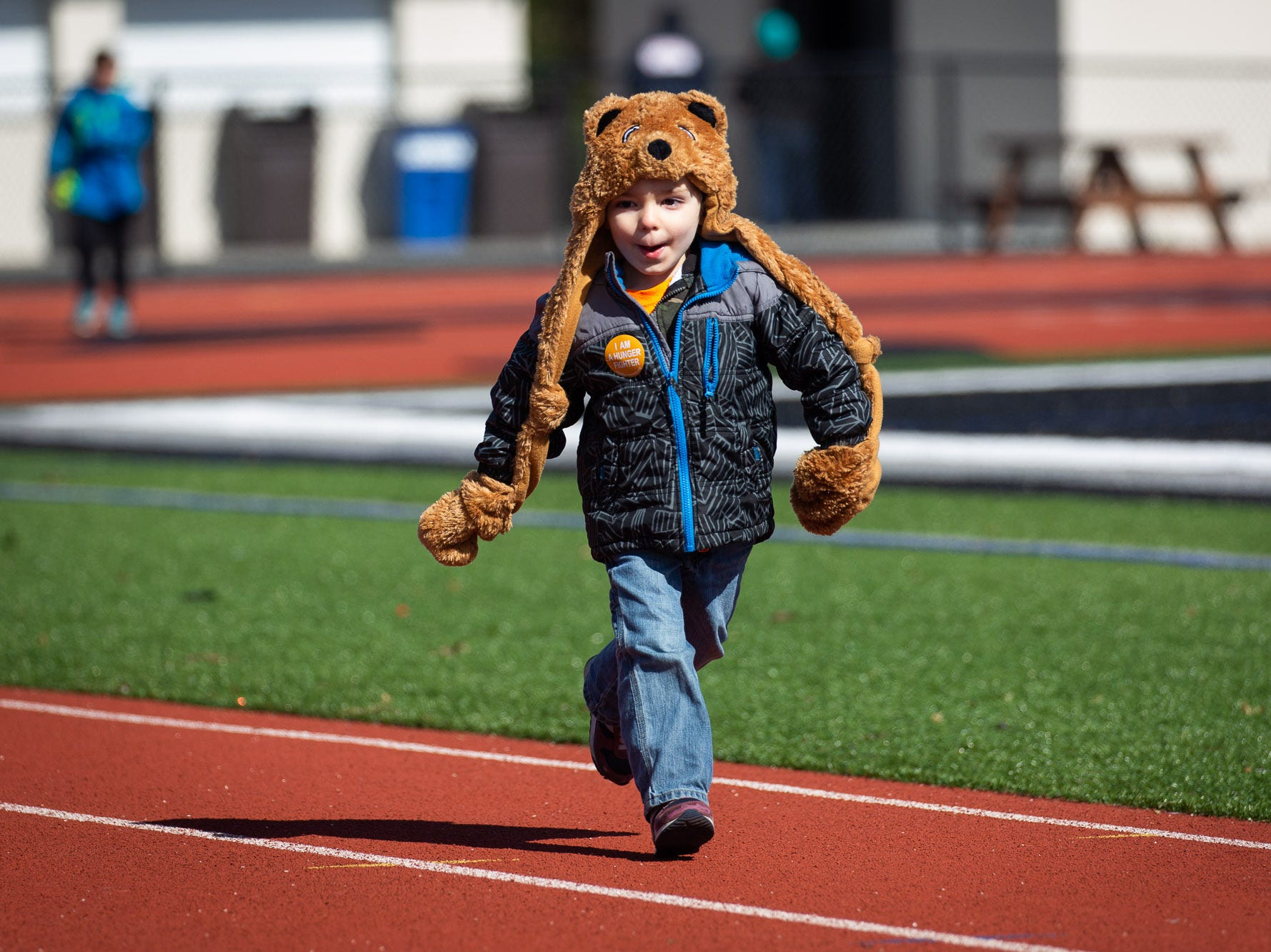 Luke Fitchett, 4, of Hanover, races down the South Western High School track while taking part in the 42nd annual Hanover Area CROP Walk, Sunday, Oct. 21 in Hanover. Fitchett was attending with his parents, Tommy and Lauren Fitchett, and siblings Nathan and Gwen.