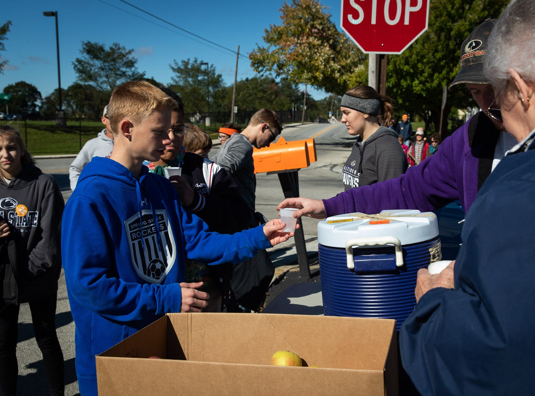 John Chantery hands out water to participants as they take part in the three-mile road course during 42nd annual Hanover Area CROP Walk, Sunday, Oct. 21 in Hanover. The CROP Walk, hosted locally by the Hanover Area Council of Churches, raises money for programs to end hunger in the Hanover area, as well as worldwide through the Church World Service.