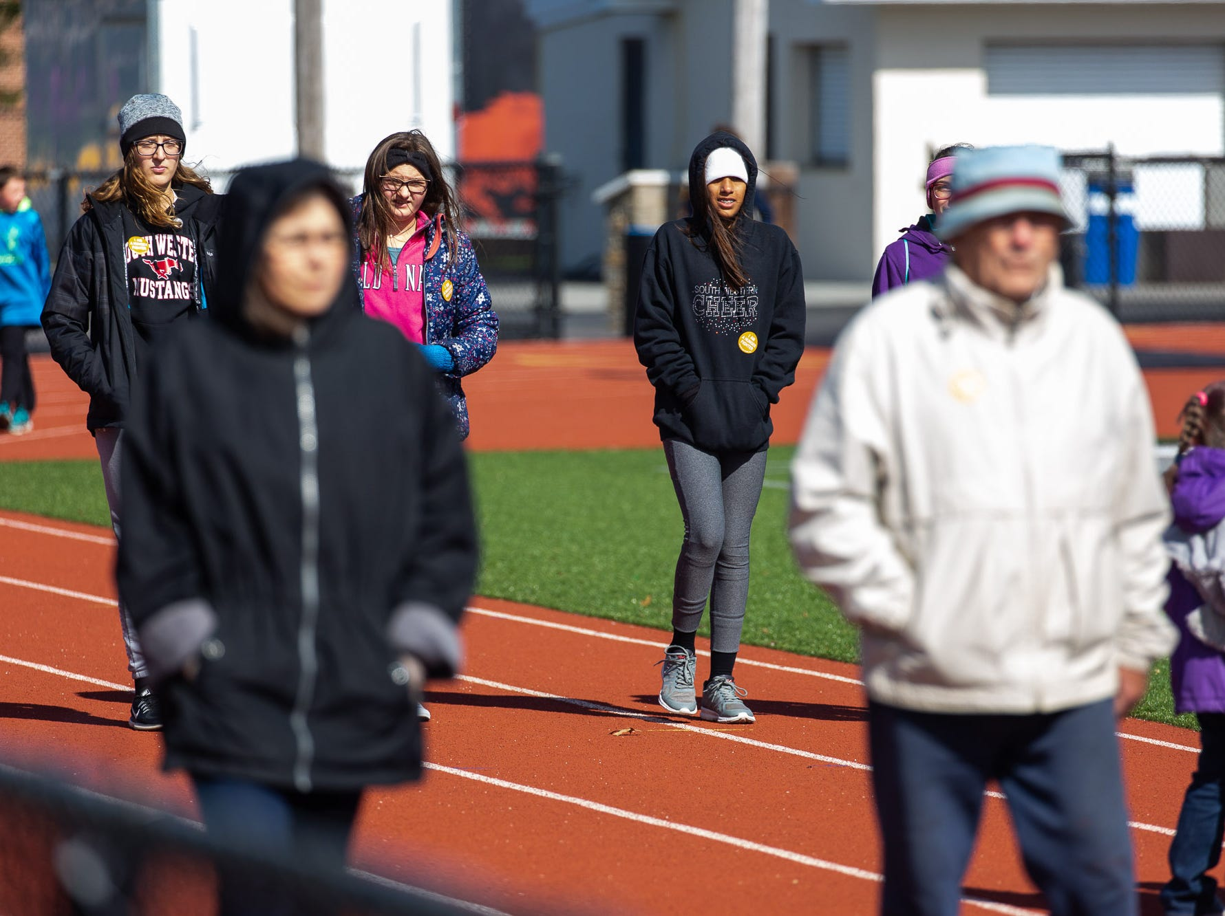 Participants walk the South Western High School track while taking part in the 42nd annual Hanover Area CROP Walk, Sunday, Oct. 21 in Hanover. The CROP Walk, hosted locally by the Hanover Area Council of Churches, raises money for programs to end hunger in the Hanover area, as well as worldwide through the Church World Service.