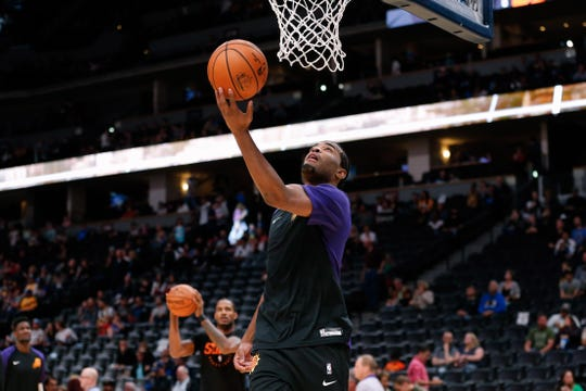 Oct 20, 2018; Denver, CO, USA; Phoenix Suns forward TJ Warren (12) warms up before the game against the Denver Nuggets at the Pepsi Center. Mandatory Credit: Isaiah J. Downing-USA TODAY Sports