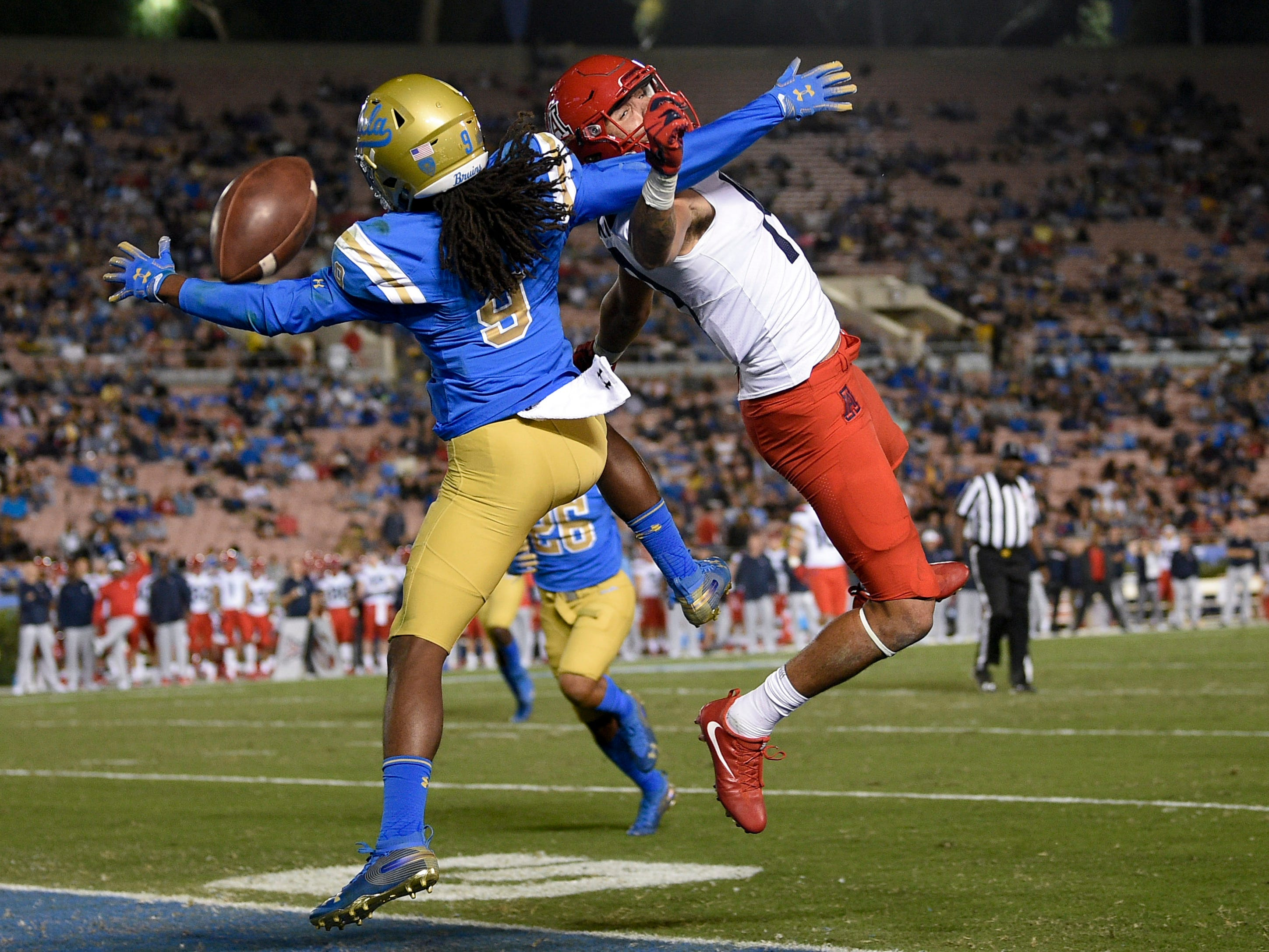 Oct 20, 2018; Pasadena, CA, USA; Arizona Wildcats wide receiver Shawn Poindexter (19) is unable to catch a pass defended by UCLA Bruins defensive back Elijah Gates (9) during the second half at Rose Bowl. Mandatory Credit: Kelvin Kuo-USA TODAY Sports