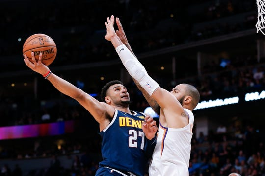 Oct 20, 2018; Denver, CO, USA; Phoenix Suns center Tyson Chandler (4) defends against Denver Nuggets guard Jamal Murray (27) in the second quarter at the Pepsi Center. Mandatory Credit: Isaiah J. Downing-USA TODAY Sports