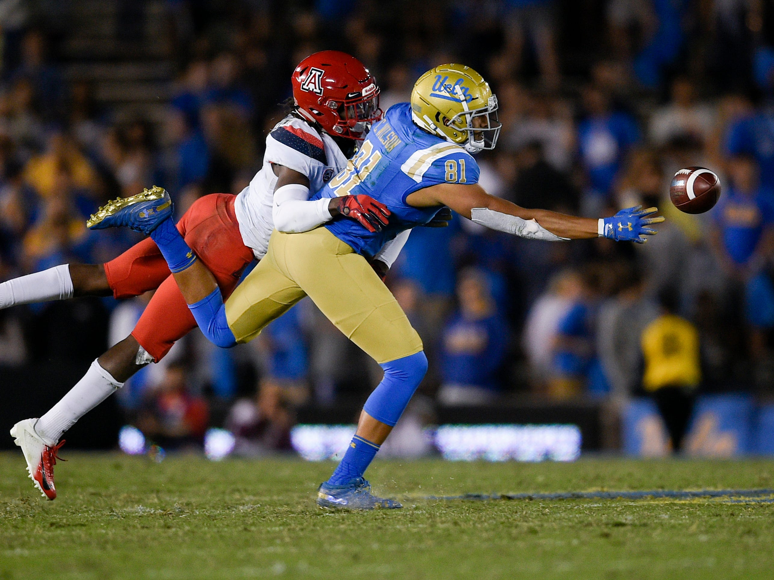 Oct 20, 2018; Pasadena, CA, USA; UCLA Bruins tight end Caleb Wilson (81) is unable to catch a pass defended by Arizona Wildcats safety Christian Young (5) during the second half at Rose Bowl. Mandatory Credit: Kelvin Kuo-USA TODAY Sports