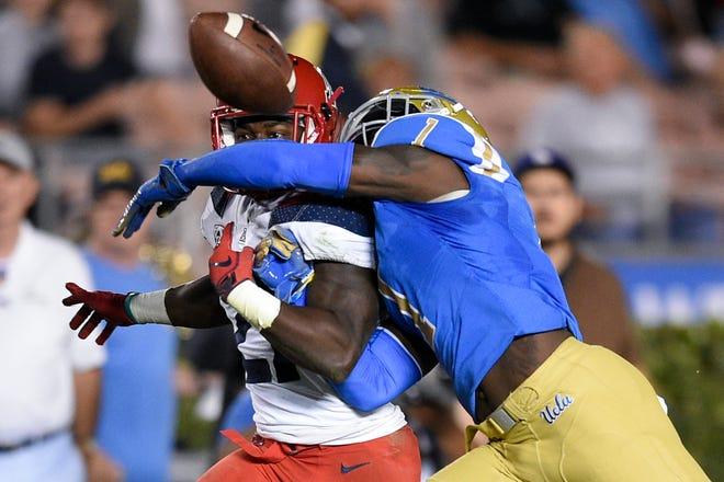 Oct 20, 2018; Pasadena, CA, USA; UCLA Bruins defensive back Darnay Holmes (1) knocks the ball away from Arizona Wildcats running back J.J. Taylor (21) for a fumble during the first half at Rose Bowl. Mandatory Credit: Kelvin Kuo-USA TODAY Sports