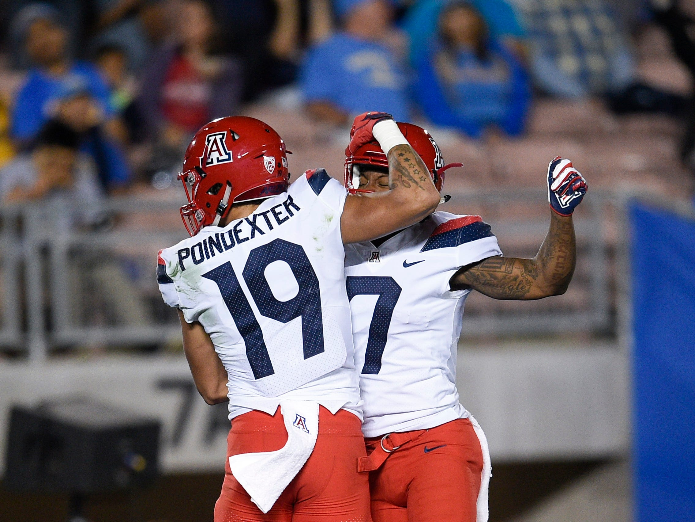 Oct 20, 2018; Pasadena, CA, USA; Arizona Wildcats wide receiver Shawn Poindexter (19) celebrates his touchdown catch with Arizona Wildcats wide receiver Devaughn Cooper (7) during the first half against the UCLA Bruins at Rose Bowl. Mandatory Credit: Kelvin Kuo-USA TODAY Sports