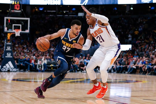 Oct 20, 2018; Denver, CO, USA; Phoenix Suns forward Richaun Holmes (21) guards Denver Nuggets guard Jamal Murray (27) in the second quarter at the Pepsi Center. Mandatory Credit: Isaiah J. Downing-USA TODAY Sports