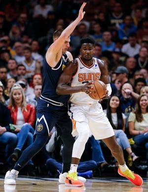 Oct 20, 2018; Denver, CO, USA; Denver Nuggets center Nikola Jokic (15) guards Phoenix Suns center Deandre Ayton (22) in the first quarter at the Pepsi Center. Mandatory Credit: Isaiah J. Downing-USA TODAY Sports