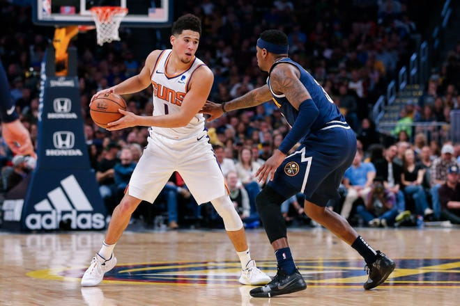 Oct 20, 2018; Denver, CO, USA; Phoenix Suns guard Devin Booker (1) controls the ball defended by Denver Nuggets forward Torrey Craig (3) in the fourth quarter at the Pepsi Center. Mandatory Credit: Isaiah J. Downing-USA TODAY Sports