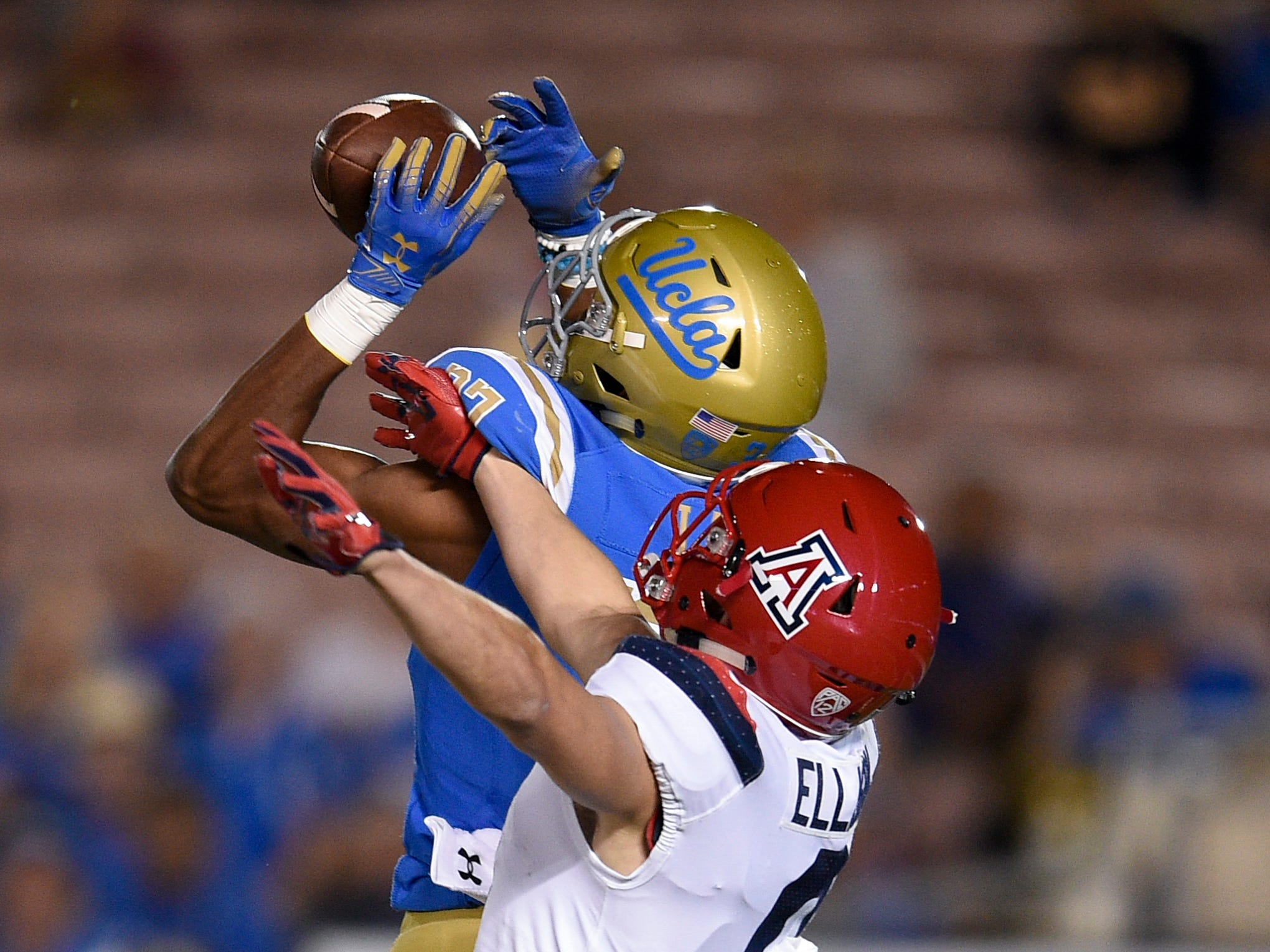 Oct 20, 2018; Pasadena, CA, USA; UCLA Bruins defensive back Quentin Lake (37) intercepts a ball intended for Arizona Wildcats wide receiver Tony Ellison (9) during the first half at Rose Bowl. Mandatory Credit: Kelvin Kuo-USA TODAY Sports
