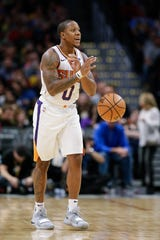 Isaiah Canaan runs the Suns' offense during the third quarter of a game against the Nuggets on Oct. 20 at the Pepsi Center.