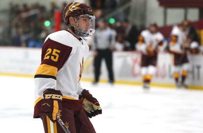 ASU's PJ Marrocco (25) waits for a puck to drop against Alaska at Oceanside Ice Arena in Tempe, Ariz. on October 7, 2018.